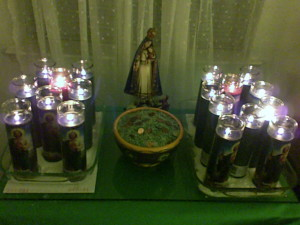 The lit Prosperity Altar for Tarot by Jacqueline