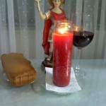 www.free-candle-spells.com_St._Expedite_blessings_received_candle_cake_wine_offering
